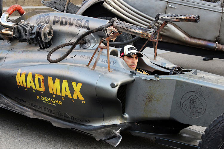 Driver Pastor Maldonado poses with the Mad Max Fury Road Lotus F1 Concept